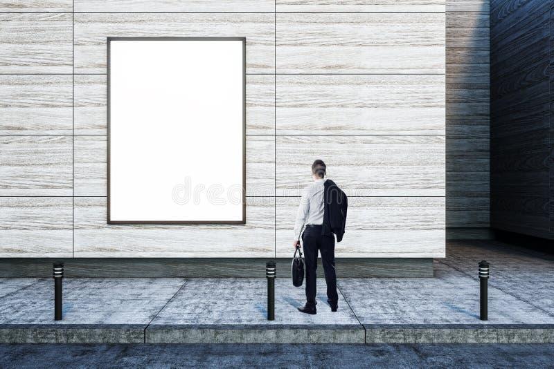 商人和空白的广告牌 免版税库存照片