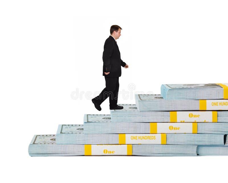 商人和金钱楼梯 图库摄影