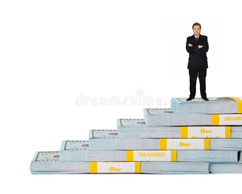 商人和金钱楼梯 库存图片