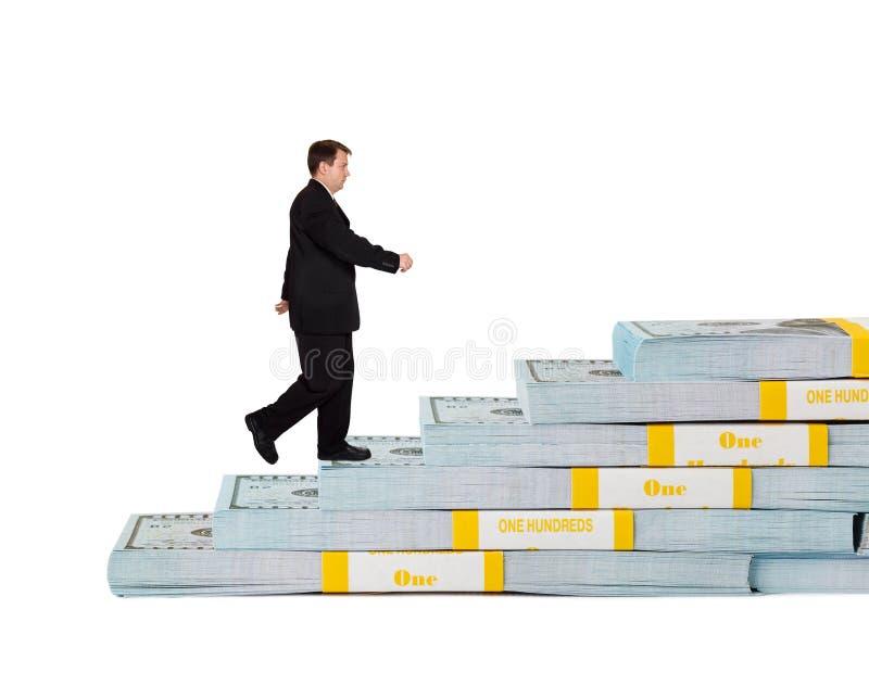 商人和金钱楼梯 免版税图库摄影