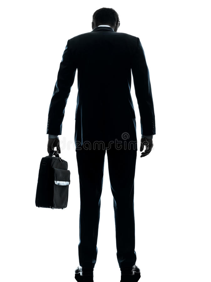 商人哀伤的常设背面图剪影 免版税图库摄影