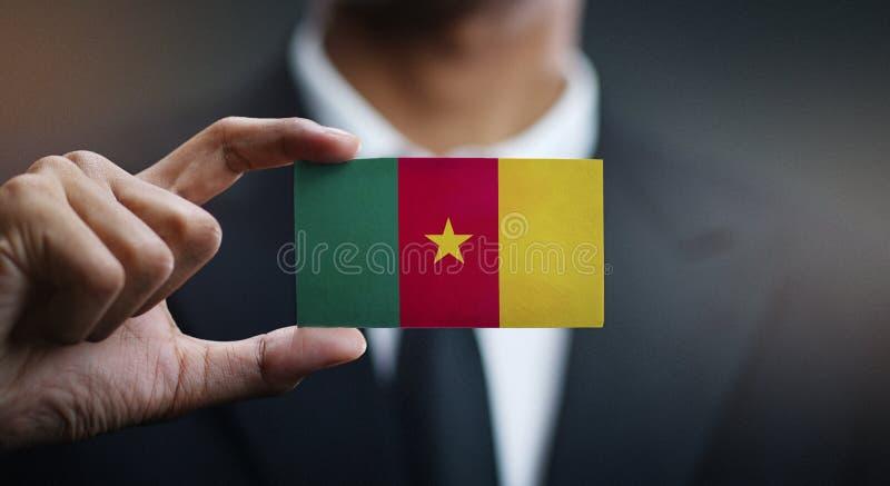商人喀麦隆旗子藏品卡片  库存照片