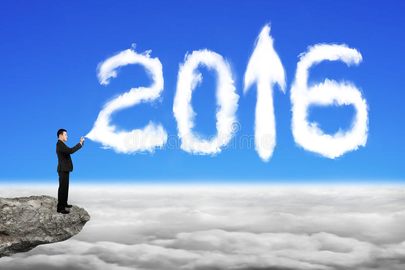 商人喷洒的白色2016年在天空cloudsca的云彩形状 库存照片