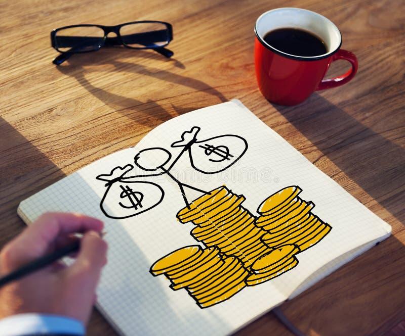 商人图画在笔记本的金钱概念 库存照片