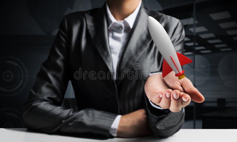 商人在手上的当前火箭 免版税库存照片