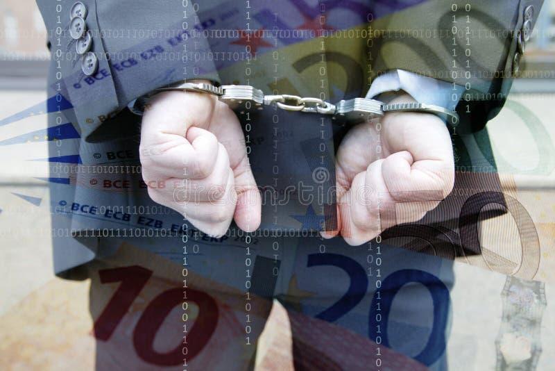 商人在手铐和欧元 免版税库存图片