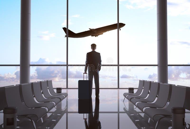商人在机场 库存照片