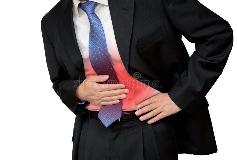 商人在痛苦中的握他的胃与stomachache或消化不良 库存照片