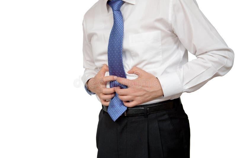 商人在痛苦中的握他的胃与stomachache或消化不良 免版税库存照片