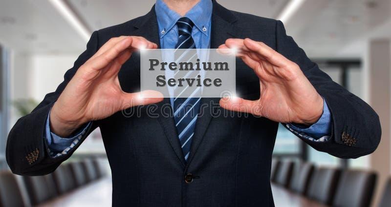 商人在他的手上举行优质服务 免版税库存照片