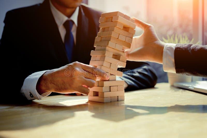 商人失败危险塔挑战比赛 免版税图库摄影