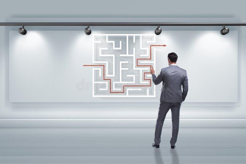 商人寻找方式从迷宫迷宫逃脱 库存图片