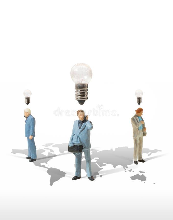 商人微型形象对成功的概念想法 库存图片
