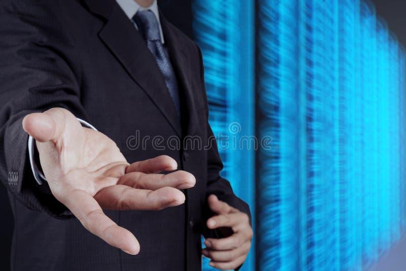 商人手和服务器室 库存图片