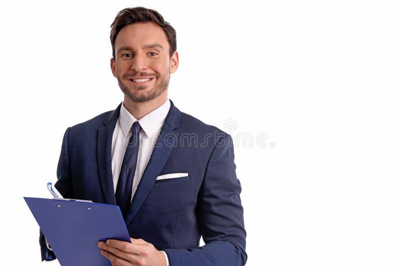 商人拿着一张空白的剪贴板 免版税库存照片