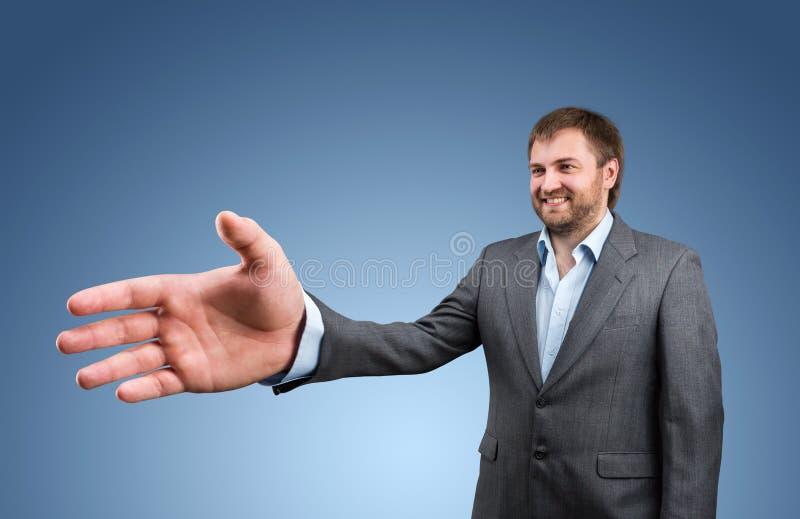 商人提供他的手 库存图片
