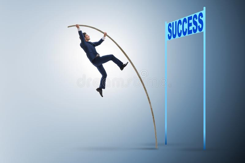 商人撑竿跳高往他的成功事业 库存图片