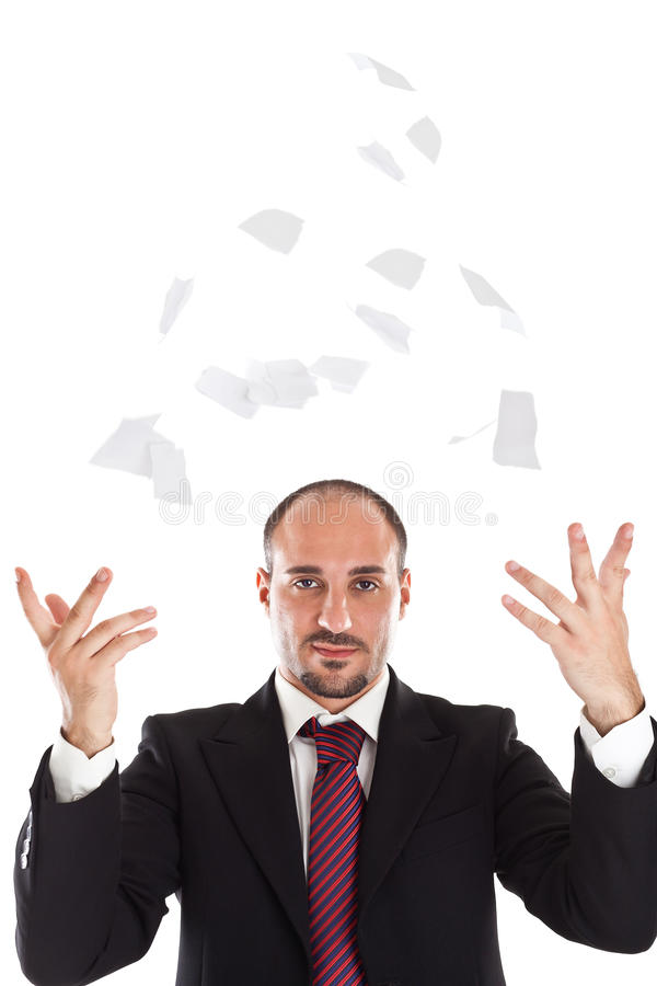 商人撕毁的和trowing的纸 免版税图库摄影