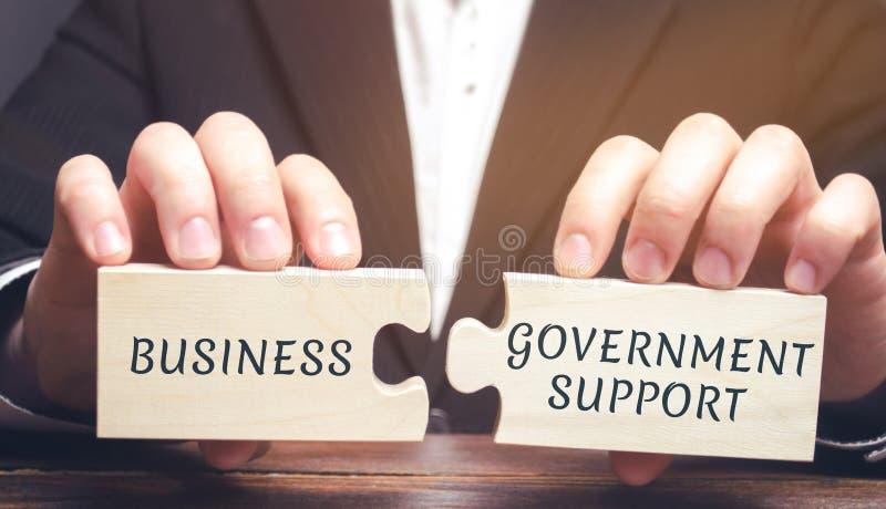 商人收集与词事务和政府支援的难题 减免税收 制造商的保护在的 免版税库存照片