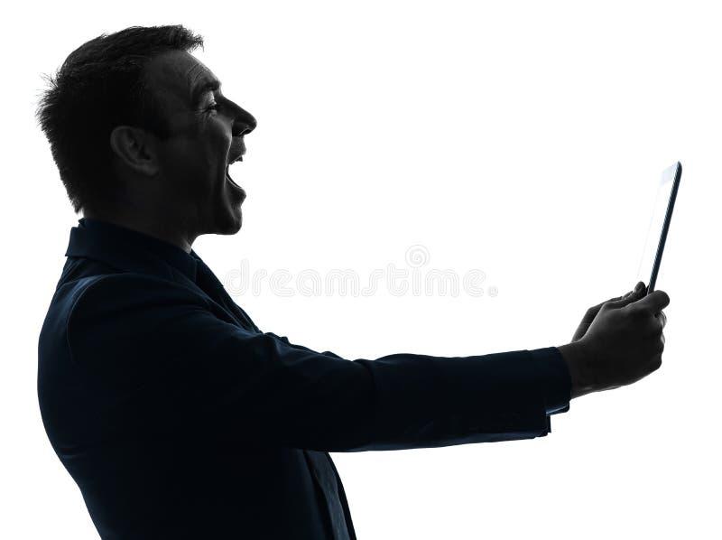 商人数字式片剂笑的剪影 免版税图库摄影