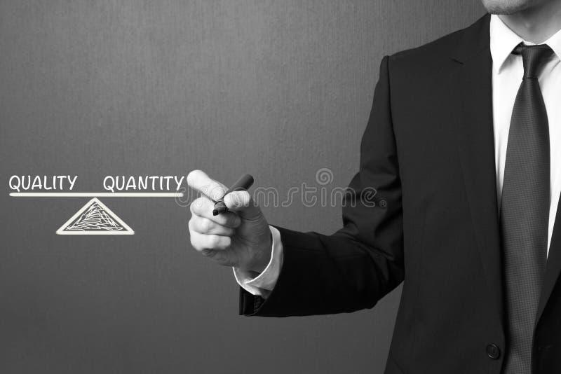 商人文字质量和数量-平衡概念 库存照片