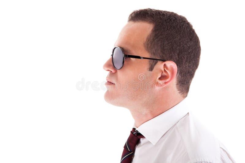 商人新配置文件的太阳镜 免版税库存图片