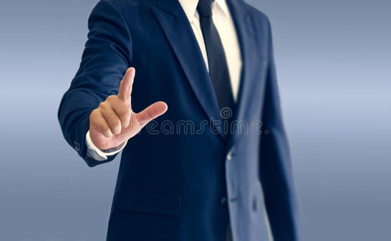 商人是站立和指向手 库存照片