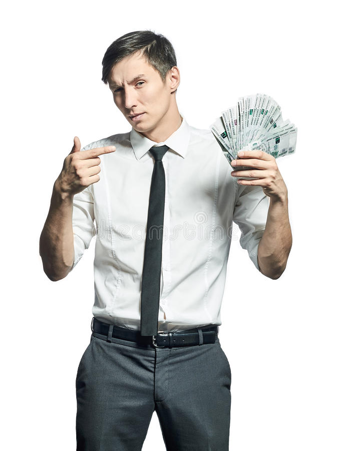 年轻商人显示库存现金的一团  库存照片