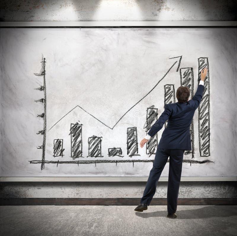 商人显示经济增长 库存照片