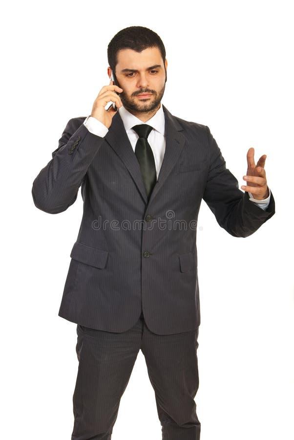 商人有交谈由电话 免版税库存照片