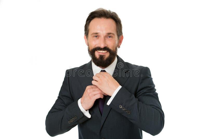 商人有胡子的成熟正装调整辅助部件 商人或经理准备成套装备 企业成套装备概念 库存图片