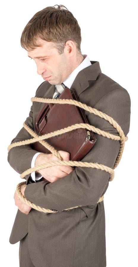 年轻商人栓与绳索 库存图片