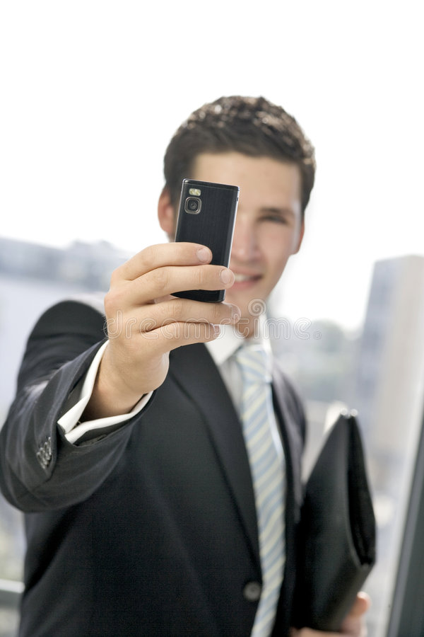 商人照片采取年轻人 图库摄影