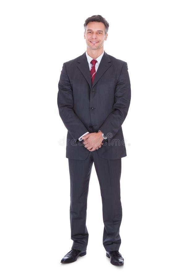 商人用手扣紧了身分反对白色背景 免版税库存照片