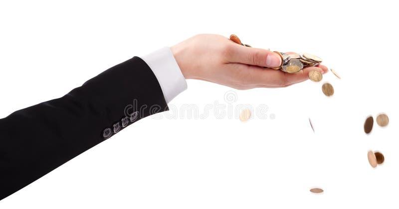 商人的手投掷的金钱 免版税库存图片