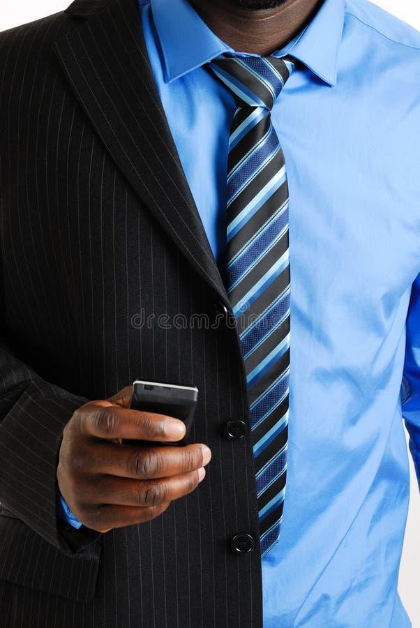 商人移动电话使用 库存照片