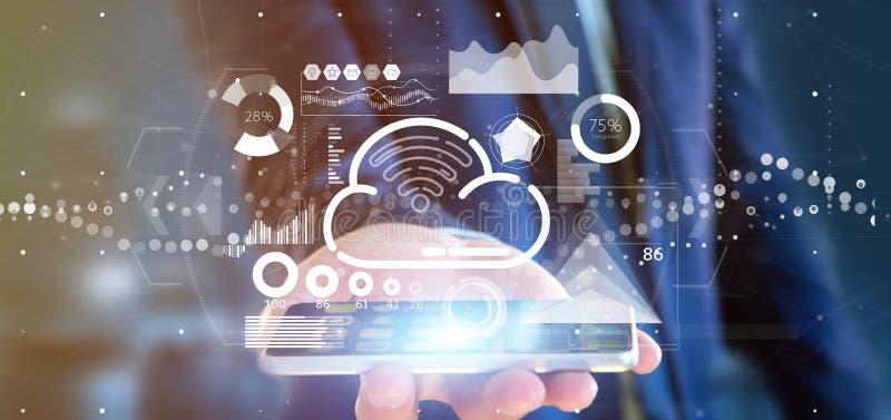 商人藏品与象、stats和数据3d翻译的云彩和wifi概念 免版税库存图片
