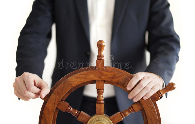 商人藏品在白色隔绝的船船舵 库存照片