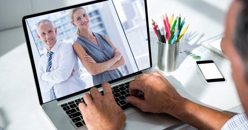 商人视讯会议的播种的图象在办公室 免版税图库摄影