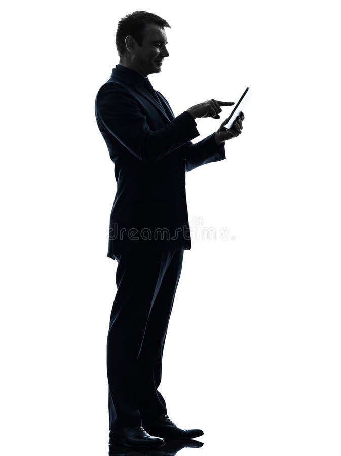 商人触摸屏幕数字式片剂剪影 库存照片