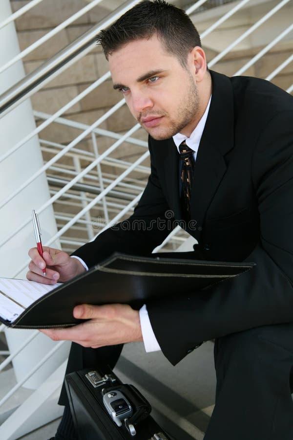 商人读取 免版税库存照片