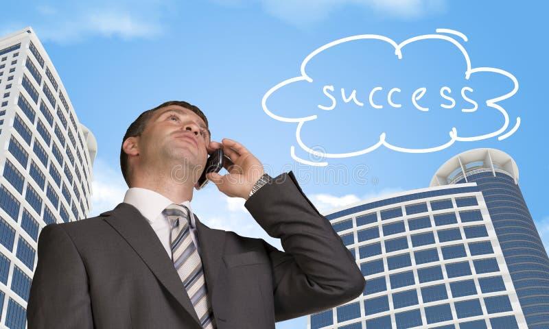 商人谈话在电话 与词的云彩 图库摄影