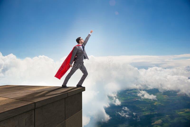 商人超级英雄成功在事业梯子概念 免版税图库摄影
