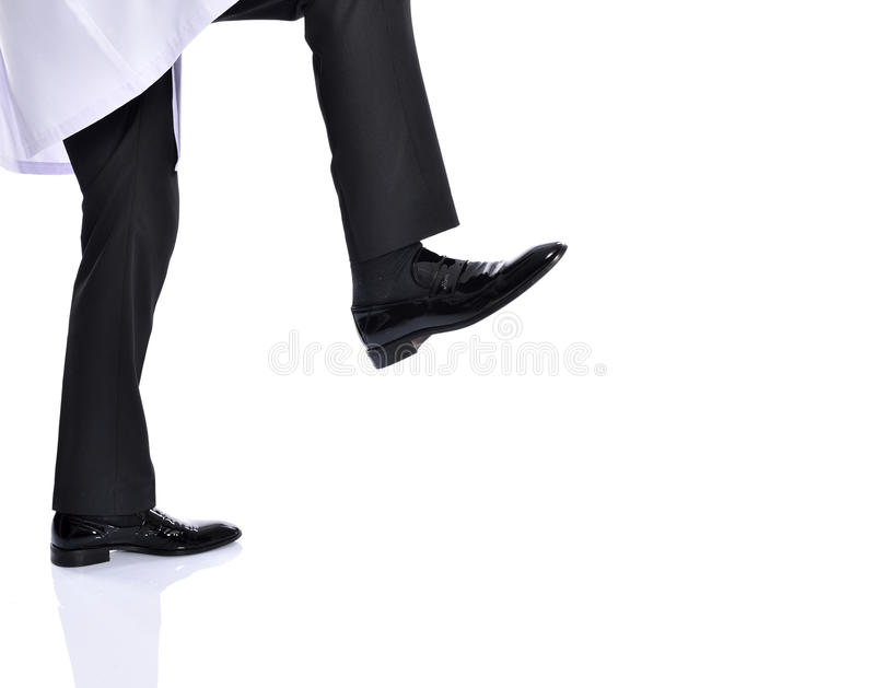 商人踢 免版税库存照片