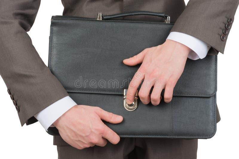 商人闭合值的手提箱 免版税库存图片