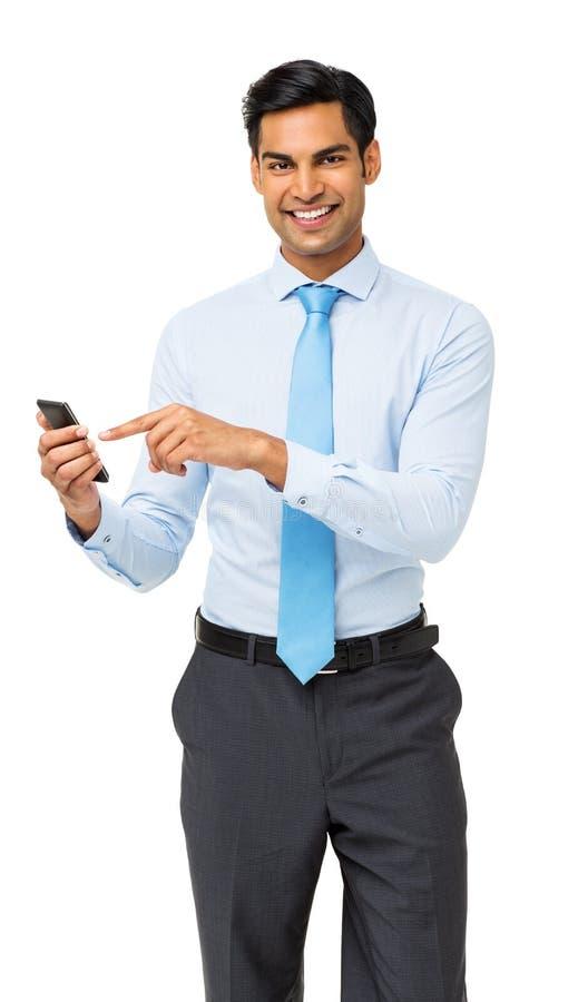 商人画象使用巧妙的电话的 免版税库存图片