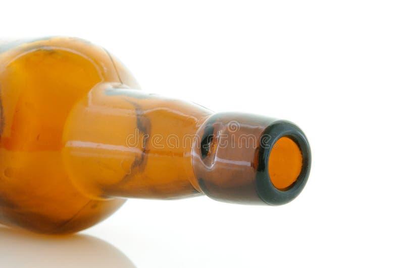 啤酒瓶轻碰顶层 免版税图库摄影
