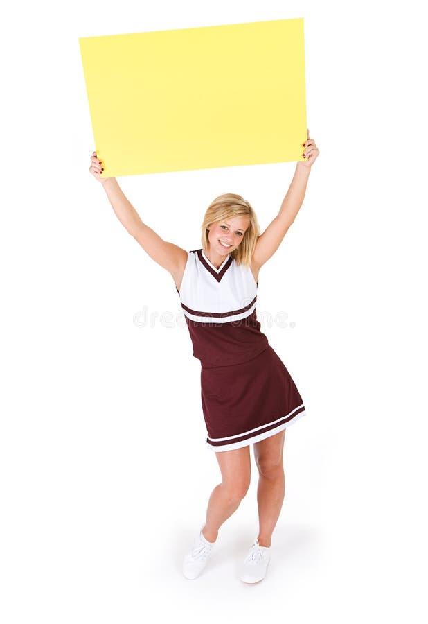 啦啦队员:逗人喜爱的少妇阻止空白的标志 免版税库存图片