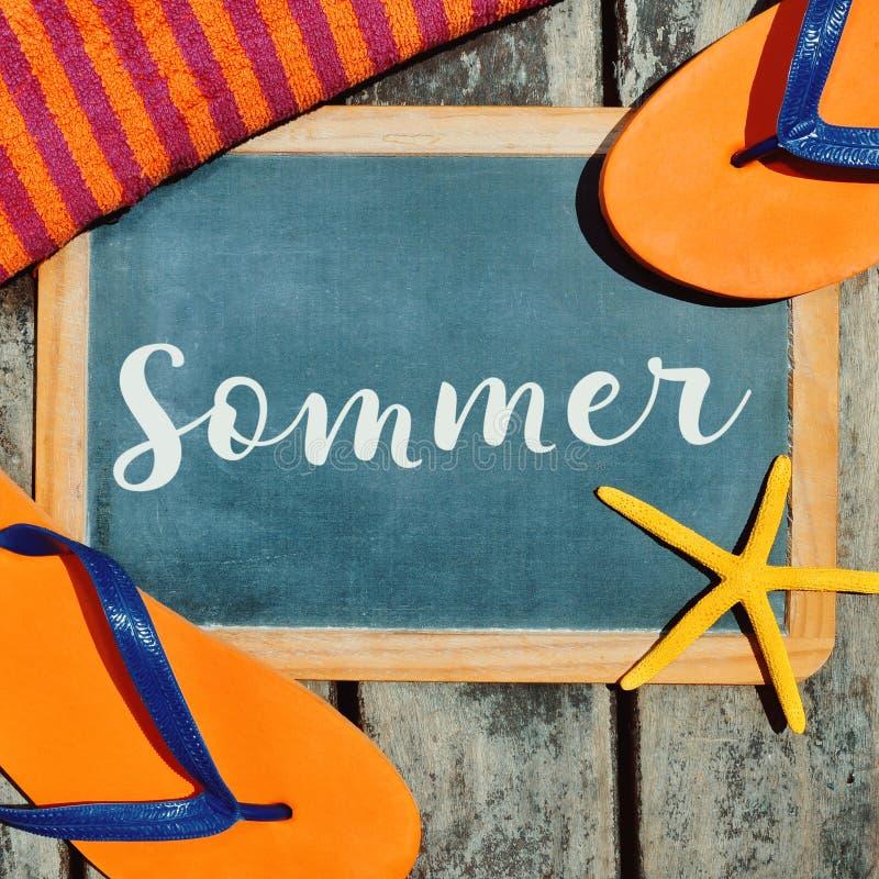 啪嗒啪嗒的响声、海星和文本sommer,夏天用德语 库存照片