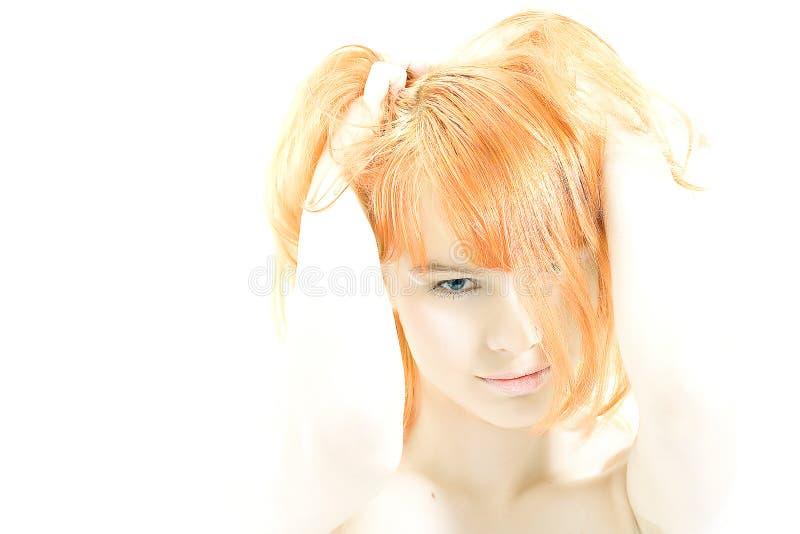 喂关键红头发人 库存照片